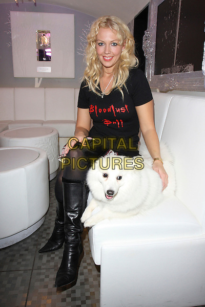 LIZ FULLER .Bloodlust Photocall to promote the forthcoming Bloodlust Ball and to promote the Blood Donor scheme, at Vendome, Piccadilly, London, England, UK, October 15th 2008.full length sitting dog pet black t-shirt slogan boots knee high.CAP/ROS.©Steve Ross/Capital Pictures