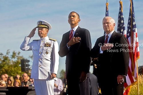 Chairman of the Joint Chiefs of Staff Admiral Mike Mullen, left, United States President Barack Obama, center, and U.S. Secretary of Defense Robert M. Gates render honors during the playing of the national anthem at the Pentagon Memorial during a ceremony marking the ninth anniversary of the September 11 attacks, Saturday, September 11, 2010. .Mandatory Credit: Cherie Cullen - DoD via CNP