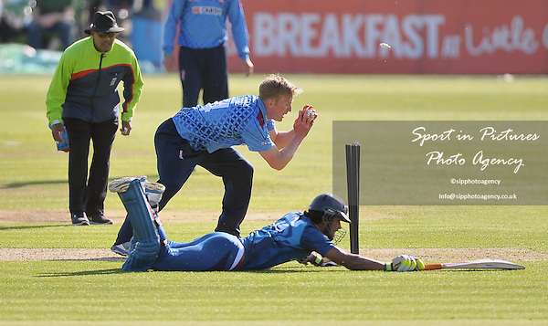 L Chandimal (Sri Lanka, wicketkeeper) dives into his crease as Adam Ball (Kent)  tries to run him outKent v Sri Lana. 50 over tour match. The Spitfire Ground. Canterbury. Kent. England. UK. 16/05/2014. MANDATORY Credit Garry Bowden/SIPPA - NO UNAUTHORISED USE - 07837 394578