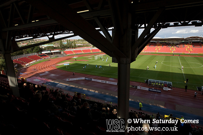Gateshead 1 Cambridge United 1, 17/09/2011. Gateshead International Stadium, Football Conference. Home fans watching the action from the main stand at the Gateshead International Stadium, the athletics stadium which is also the home ground of Gateshead FC, as the club play host to Cambridge United in a Blue Square Bet Premier division fixture. The match ended in a one-all draw, watched by a crowd of 904. The point meant Gateshead went to the top of the division, one below the Football League in England. Photo by Colin McPherson.