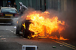 © Joel Goodman - 07973 332324 . 08/08/2011 . London , UK . A car is set alight in Hackney on a 3rd night of rioting and looting in London , which followed a protest against the police shooting of Mark Duggan in Tottenham . Photo credit : Joel Goodman