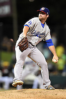 Chattanooga Lookouts pitcher Daniel Coulombe (18) delivers a pitch during game three of the Southern League Championship Series against the Jacksonville Suns on September 12, 2014 at Bragan Field in Jacksonville, Florida.  Jacksonville defeated Chattanooga 6-1 to sweep three games to none.  (Mike Janes/Four Seam Images)