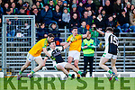 Killian Young South Kerry in action against James O'Donoghue Legion at the Kerry County Senior Football Final at Fitzgerald Stadium on Sunday.