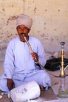 Man smoking water pipe in Cairo Egypt