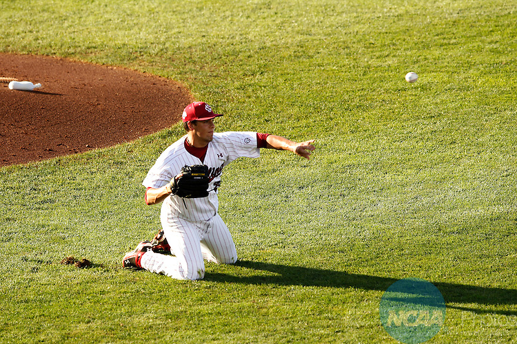 29 JUNE 2010:  Michael Roth (29) of the University of South Carolina throws out a runner at first against UCLA during the Division I Men's Baseball Championship held at Rosenblatt Stadium in Omaha, NE.  South Carolina defeated UCLA 2-1 for the national title.  Jamie Schwaberow/NCAA Photos