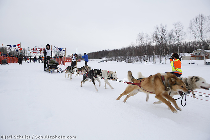 Noah Pereira and dog team leaves the start line of the 2013 Junior Iditarod on Knik Lake.  Knik Alaska..Photo by Jeff Schultz/IditarodPhotos.com   Reproduction prohibited without written permission