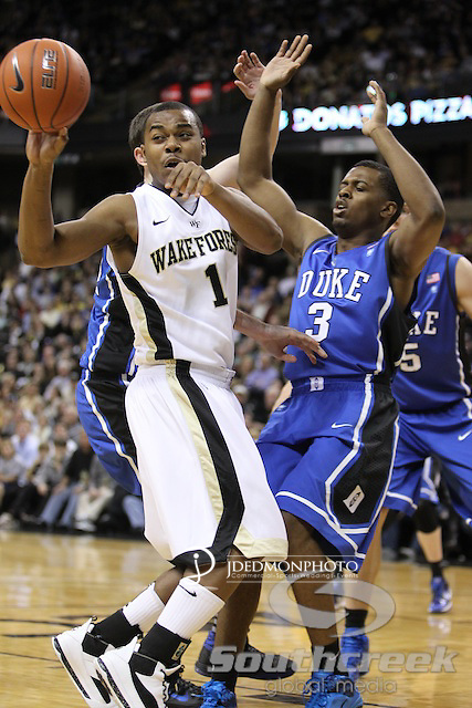 Wake Forest Demon Deacons guard Tony Chennault (1) dishes back as Duke Blue Devils guard Tyler Thornton (3) applies the pressure.Duke leads at halftime 41-32.