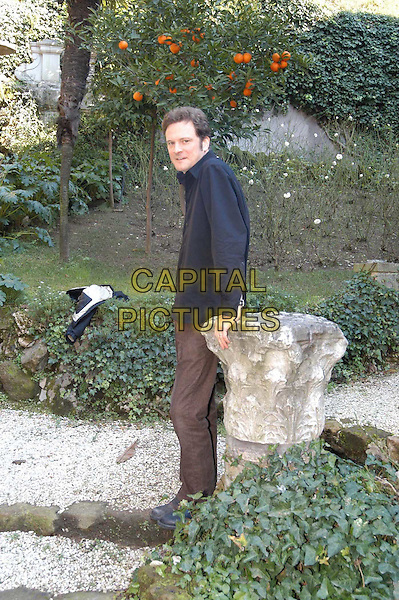 COLIN FIRTH.3 December 2003.brown trousers, leaning, full length, full-length, blue, black shirt.www.capitalpictures.com.sales@capitalpictures.com.© Capital Pictures