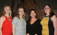 NWA Democrat-Gazette/CARIN SCHOPPMEYER Ali Demorotski, exhibition curator (from left), Jessi Mueller, Emily Rodriguez and Samantha Sigmon, welcome guests to Border Cantos.