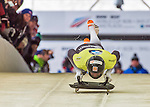 9 January 2016: Martins Dukurs, competing for Latvia, pushes off for his first run start of the BMW IBSF World Cup Skeleton race at the Olympic Sports Track in Lake Placid, New York, USA. Martins Dukurs ended the day with a combined 2-run time of 1:48.28 and a resulting gold medal. Mandatory Credit: Ed Wolfstein Photo *** RAW (NEF) Image File Available ***