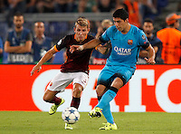 Calcio, Champions League, Gruppo E: Roma vs Barcellona. Roma, stadio Olimpico, 16 settembre 2015.<br /> FC Barcelona&rsquo;s Luis Suarez, right, is challenged by Roma&rsquo;s Lucas Digne during a Champions League, Group E football match between Roma and FC Barcelona, at Rome's Olympic stadium, 16 September 2015.<br /> UPDATE IMAGES PRESS/Riccardo De Luca