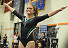 Claire Dempsey of Ward Melville turns to the judges after vaulting in the Suffolk County varsity girls' gymnastics individual championships at Babylon High School on Friday, November 6, 2015.<br /> <br /> James Escher