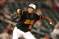 Rochester Red Wings relief pitcher Jose Lugo (19) delivers a pitch during a game vs. the Scranton Wilkes-Barre Yankees at Frontier Field in Rochester, New York;  July 5, 2010.   Scranton defeated Rochester 9-5.  Photo By Mike Janes/Four Seam Images