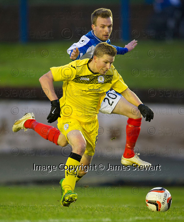 Queen of the South's Derek Young tries to get away from Cowdenbeath's Kyle Miller.