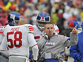 Landover, MD - November 30, 2008 -- New York Giants defensive coordinator Steve Spagnuolo points to the field as he sets the defense with linebacker Antonio Pierce (58), Danny Clark (55), and Michael Johnson (20) in the first quarter against the Washington Redskins at FedEx Field in Landover, Maryland on Sunday, November 30, 2008..Credit: Ron Sachs / CNP.(RESTRICTION: No New York Metro or other Newspapers within a 75 mile radius of New York City)