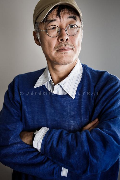 Kamakura, November 26 2013 - Portrait of Japanese novelist Gen'ichiro Takahashi at Myohonji temple, near his house.
