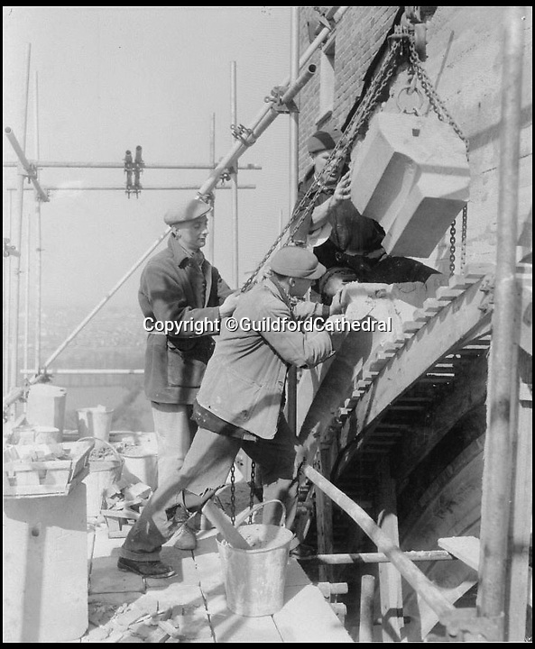 BNPS.co.uk (01202 558833)<br /> Pic: GuildfordCathedral/BNPS<br /> <br /> Finishing of in the early 1960's.<br /> <br /> Bad omens..<br /> <br /> One of Britains great cathedral's could be closed down if an emergency appeal for &pound;1.3 million is not successful by the end of August.<br /> <br /> Historic Guildford cathedral, where cult horror film The Omen was filmed, is facing closure because its ceiling is laced with asbestos.<br /> <br /> The 10,000sq ft ceiling of Guildford Cathedral was sprayed with a special acoustic plaster made from the deadly mineral in a bid to improve the sound quality when it was built in the 1960s.<br /> <br /> Fifty years on the ceiling has started to crumble forcing church bosses to launch an appeal to raise &pound;7 million pounds to pay for its restoration.<br /> <br /> They say that if the money can't be raised they will have no choice but to close its doors for good - the first British cathedral ever to do so.<br /> <br /> To add further pressure to the campaign, they have to raise 1.3 million pounds by the end of August in order to qualify for a Heritage Lottery Fund.<br /> <br /> More than 200,000 people paid two shillings and sixpence - the equivalent of 12.5 pence today - to buy a brick when the price of building materials shot up after World War II.