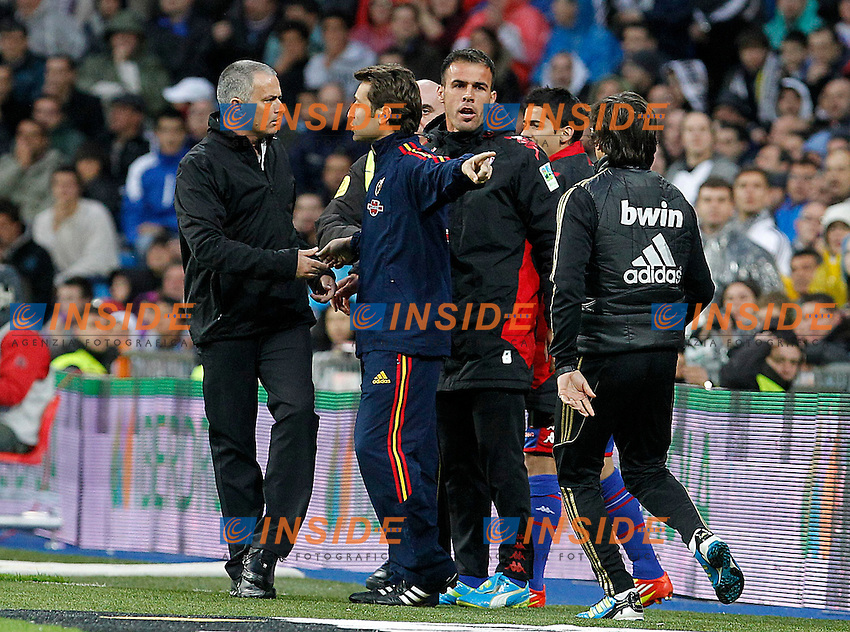 Real Madrid's Jose Mourinho have words with Sporting de Gijon's David Barral (r) and the fourth referee Alonso Vizuete Sanchez (c).Madrid 14/4/2012 Stadio Santiago Bernabeu.Football Calcio 2011/2012 Liga Spagna.Real Madrid Vs Sporting Gijon.Foto Insidefoto / Alterphotos / Acero Italy ONLY