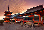 Kiyomizu-dera Buddhist temple, Sanjunoto pagoda, Kaisan-do and Kyo-do hall. Beautiful sunrise scenery with dramatic red sky. Kyoto, Japan 2017.