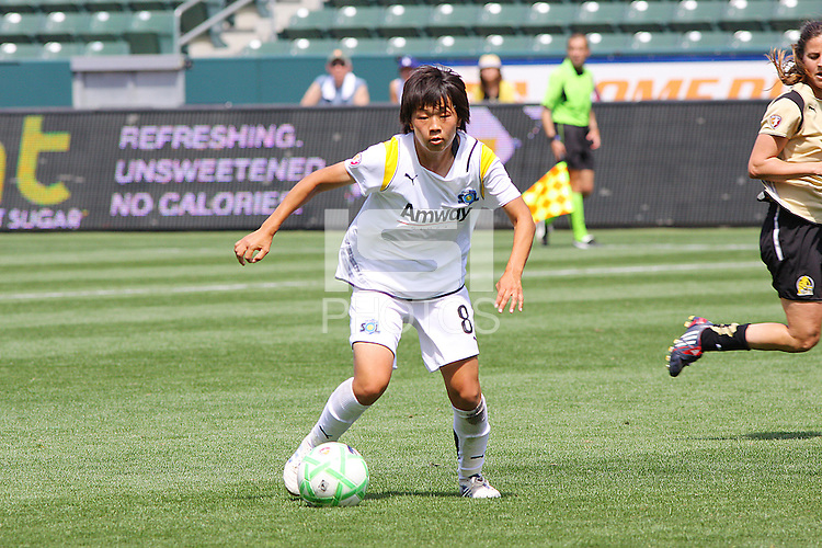 Aya Miyama #8 of the Los Angeles Sol attacks the defense of FC Gold Pride during their match at Home Depot Center on April 19, 2009 in Carson, California.