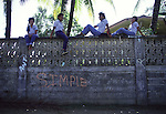 High school girls sit on top a wall  in the shade from the hot subtropical sun.the island republic of Palau has been everything from a Japanese military base to a U.S. Trust territory it now seeks profitable indignity as a plush Pacific resort. The Republic of Belau lies 1,300 kilometers, southwest of Guam, and 600 kilometers east of the Philippines. (Jim Bryant Photo).....