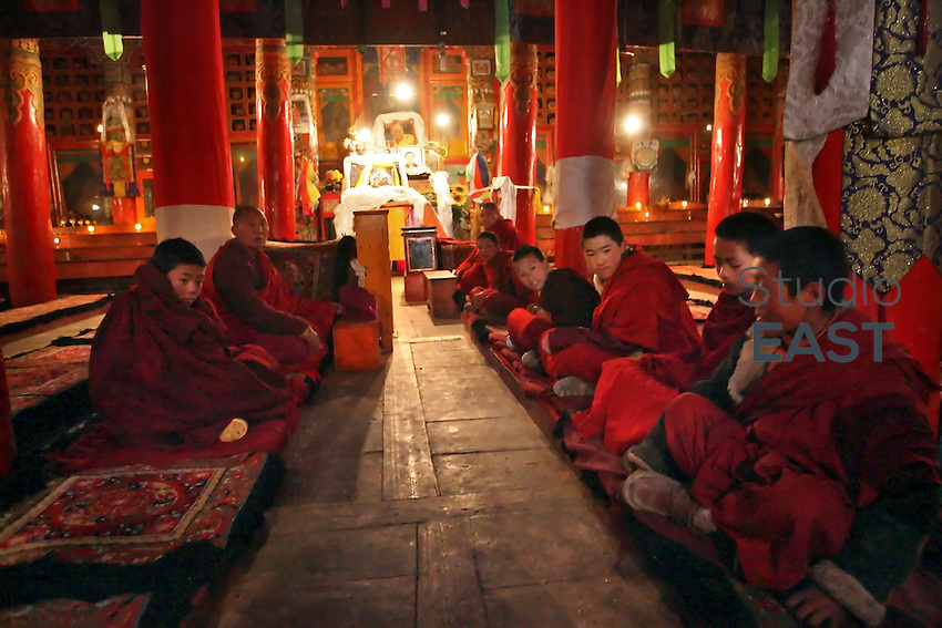 Young monks get ready for prayer in Kunghua monastery, in Tibetan region, China, on March 22, 2008. Kunghua monastery has been surrounded by Chinese police and its monks forced to stay inside in order to prevent them to join the Tibetan protesting movement that started on March 10. Photo by Lucas Schifres/Pictobank