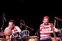 Brad Corrigan (right) and members of his band perform at the Paramount Theater in Denver, CO before the USA Men's National Team prep rally on March 21, 2013.