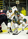 29 December 2010: University of Vermont Catamount forward Brett Leonard (26), a Senior from South Burlington, VT, digs for the puck with teammate H.T. Lenz (11) during action against the 2011 U.S. Men's National University Team in an exhibition game at Gutterson Fieldhouse in Burlington, Vermont. The Catamounts defeated the National team 7-1. Mandatory Credit: Ed Wolfstein Photo