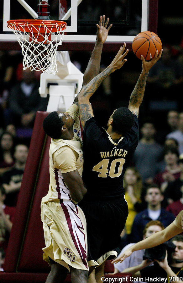 TALLAHASSEE, FL 2/1/11-FSU-WF MBB11 CH-Florida State's Bernard James defends Wake Forest's Ty Walker during first half action Tuesday at the Donald L. Tucker Center in Tallahassee...COLIN HACKLEY PHOTO