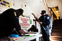 New Jersey, United States. 15th February 2013 -- NJ's police officers organize and tag some weapons after being acquired during the Gun Buyback program in New Jersey. Photo by Eduardo Munoz Alvarez / VIEWpress.