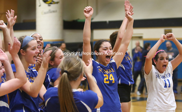 EAST HAVEN CT. 19 November 2016-111916SV06-#24 Samantha Diorio-Torres and #11 Shari Minalga of Seymour High celebrate with teammates after beating Torrington High 3-0 in the CIAC Class M Volleyball championship game at East Haven High in East Haven Saturday.<br /> Steven Valenti Republican-American