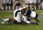 Colorado State's DeAndre Elliott (13) tackles Nevada's Jerico Richardson (84) during the second half of an NCAA college football game in Reno, Nev., on Saturday, Oct. 11, 2014. Colorado State won 31-24. (AP Photo/Cathleen Allison)
