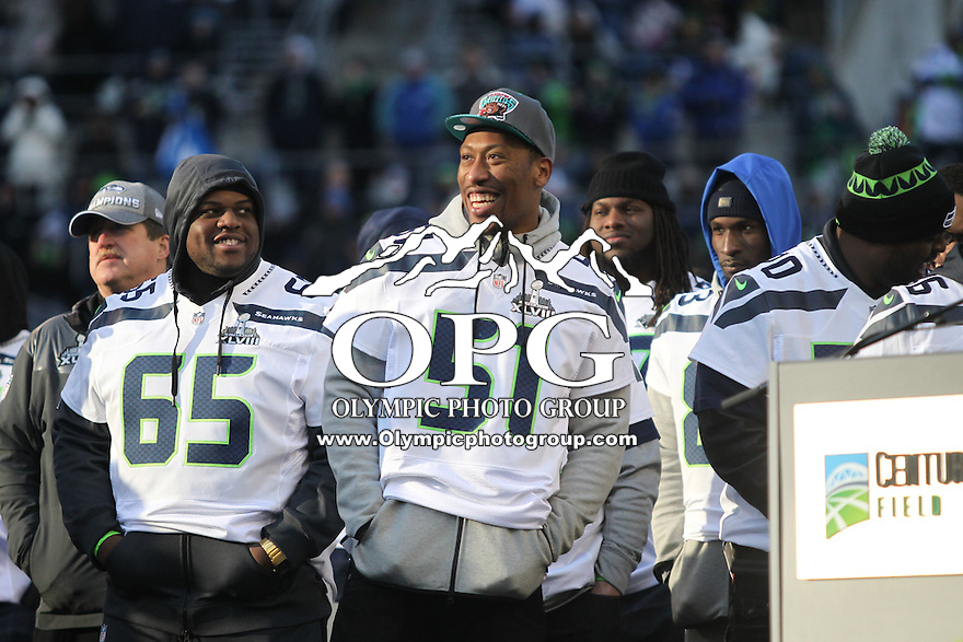 2014-02-05:  Seattle Seahawk Bruce Irvin was all smiles during the celebration party on the field.  Seattle Seahawks players and 12th man fans celebrated bringing the Lombardi trophy home to Seattle during the Super Bowl Parade at Century Link Field in Seattle, WA.
