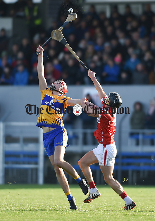 Peter Duggan of Clare in action against Eoin Cadogan of Cork during their Munster Hurling League game at Cusack Park. Photograph by John Kelly.