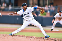 Asheville Tourists starting pitcher Antonio Santos (10) delivers a pitch during a game against the Augusta GreenJackets at McCormick Field on July 16, 2017 in Asheville, North Carolina. The Tourists defeated the GreenJackets 12-3. (Tony Farlow/Four Seam Images)