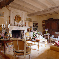 The living room or 'salon' has been furnished with French antiques found in local flea markets and auctions