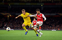 Reiss Nelson of Arsenal shoots at goal under pressure from Mergim Vojvoda of Standard Liege during the UEFA Europa League match between Arsenal and Standard Liege at the Emirates Stadium, London, England on 3 October 2019. Photo by Andrew Aleks.