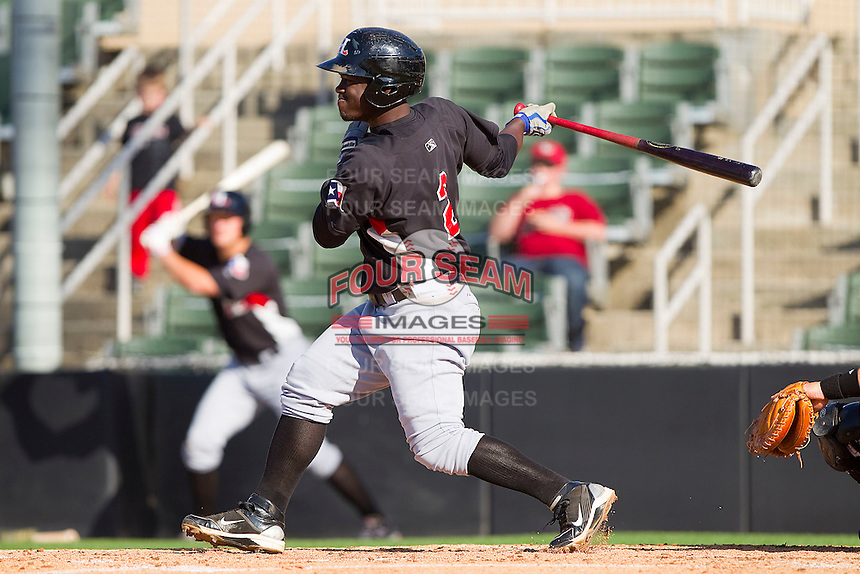 Odubel Herrera #2 of the Hickory Crawdads follows through on his swing against the Kannapolis Intimidators at Fieldcrest Cannon Stadium on April 17, 2011 in Kannapolis, North Carolina.   Photo by Brian Westerholt / Four Seam Images