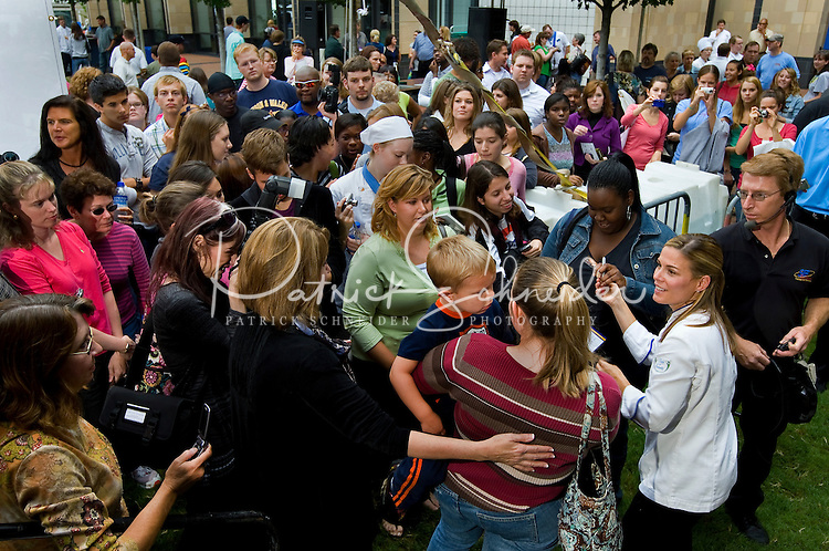 Iron Chef America star Cat Cora is slammed with autograph requests during the 2008 Charlotte Shout culinary festival in downtown Charlotte, NC. Shout is a month-long celebration of art, culture, entertainment and culinary excellence.