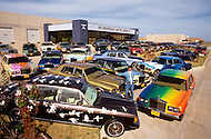 Texas, 1986. Bhawan Rajneesh (now known as Osho) possessed more than 20 Rolls-Royce cars and never used the same car two days in a row. Rajneeshpuram, was an intentional community in Wasco County, Oregon, briefly incorporated as a city in the 1980s, which was populated with followers of the spiritual teacher Osho, then known as Bhagwan Shree Rajneesh. The community was developed by turning a ranch from an empty rural property into a city complete with typical urban infrastructure, with population of about 7000 followers.