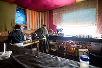 Sami Restaurant's Kitchen. <br /> <br /> Calais Jungle Camp.<br /> <br /> Under the Sky of Calais &amp; Dunkirk. Two Camps, Two Sides of the Same Coin: Not 'migrants', Not 'refugees', just Humans.<br /> <br /> France, 24-30/03/2016. Documenting (and following) Zekra and her experience in the two French camps at the gate of the United Kingdom: Calais' &quot;Jungle&quot; and Dunkirk's &quot;Grande-Synthe&quot;. Zekra lives in London but she is originally from Basra in Iraq. Zekra and her family had to flee Kuwait - where they moved for working reason - due to the &quot;Gulf War&quot;, and to the Western Countries' will to &quot;export Democracy in Iraq&quot;. Zekra is a self-motivated volunteer and founder of &quot;Happy Ravers&quot;, a group of people (not a NGO or a charity) linked to each other because of their love for rave parties but also men and women who meet up every week to help homeless people and other people in need in Central London. (Here there are some of the stories I covered about Zekra and &quot;Happy Ravers&quot;: http://bit.ly/1XVj1Cg &amp; http://bit.ly/24kcGQz &amp; http://bit.ly/1TY0dPO). Zekra worked as an English teacher in the adult school at Dunkirk's &quot;Grande-Synthe&quot; camp and as a cultural mediator and Arabic translator for two medic teams in Calais' &quot;Jungle&quot;. Please read her story at the beginning of this reportage.