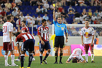 Referee Terry Vaughn issues a yellow card to Osael Romero (7) for a foul on Chris Albright (3) of the New York Red Bulls. The New York Red Bulls defeated Chivas USA 1-0 during a Major League Soccer (MLS) match at Red Bull Arena in Harrison, NJ, on June 5, 2010.