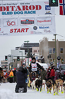 Matt Hall and team leave the ceremonial start line with an Iditarider and handler at 4th Avenue and D street in downtown Anchorage, Alaska on Saturday March 3rd during the 2018 Iditarod race. Photo ©2018 by Brendan Smith/SchultzPhoto.com