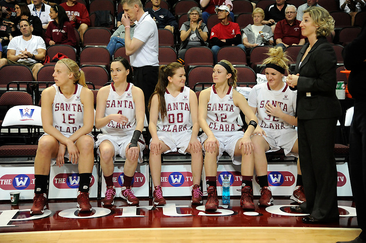 March 6, 2014; Las Vegas, NV, USA; Santa Clara Broncos forward Marie Bertholdt (15), guard Ricki Radanovich (4), guard Montana Walters (00), guard Nici Gilday (12), forward Jo Paine (32), and head coach Jennifer Mountain (right) against the Pepperdine Waves before the game of the WCC Basketball Championships at Orleans Arena. The Waves defeated the Broncos 80-74.