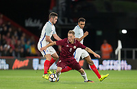 Andrejs Ciganiks (Schalke 04 Gelsenkirchen II) of Latvia U21 turns Trent Alexander-Arnold (Liverpool) & Lewis Cook (Bournemouth) of England U21 during the UEFA EURO U-21 First qualifying round International match between England 21 and Latvia U21 at the Goldsands Stadium, Bournemouth, England on 5 September 2017. Photo by Andy Rowland.