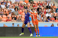 Houston, TX - Saturday June 17, 2017: Alanna Kennedy heads the ball over Morgan Brian during a regular season National Women's Soccer League (NWSL) match between the Houston Dash and the Orlando Pride at BBVA Compass Stadium.