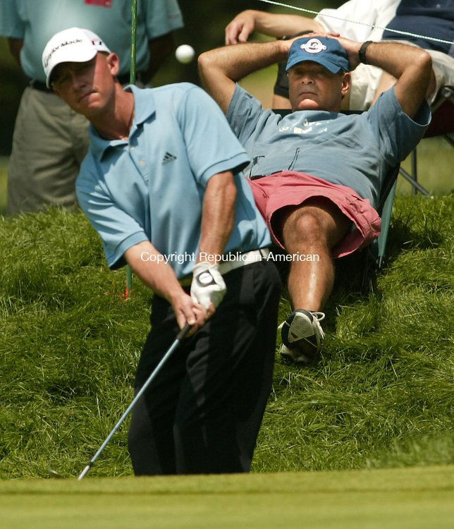 CROMWELL, CT 30 JUNE 2006 063006BZ13- Bob Olesak,of Kensington, CT, relaxes in a chair as Nathan Green chips to the 7th green<br /> during the second round of the 2006 Buick Championship at TPC River Highlands in Cromwell Wednesday. <br /> Jamison C. Bazinet Republican-American