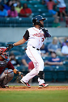 Arkansas Travelers left fielder Keury De La Cruz (34) follows through on a swing during a game against the Frisco RoughRiders on May 26, 2017 at Dickey-Stephens Park in Little Rock, Arkansas.  Arkansas defeated Frisco 4-2.  (Mike Janes/Four Seam Images)