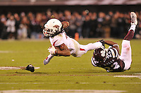 NWA Media/Michael Woods --11/01/2014-- w @NWAMICHAELW... Arkansas receiver Keon Hatcher is tripped up by Mississippi State defender Matt Wells in the 3rd quarter of Saturday nights game against Mississippi State at Davis Wade Stadium in Starkville, Mississippi.