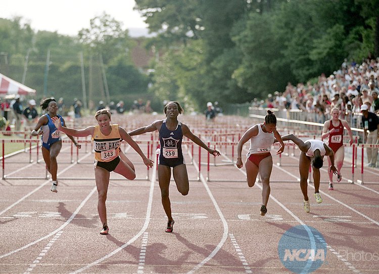 27 MAY 2000:  Shawntel Newhouse of Abilene Christian University surges for the finish line in the women's 100 M Hurdles during the 2000 NCAA Division 2 Track and Field competition hosted by St. Augustine College at Paul Derr Stadium on the North Carolina State University Campus in Raleigh, NC.  Newhouse placed first in the event to win the national title.Brett Wilhelm/NCAA Photos